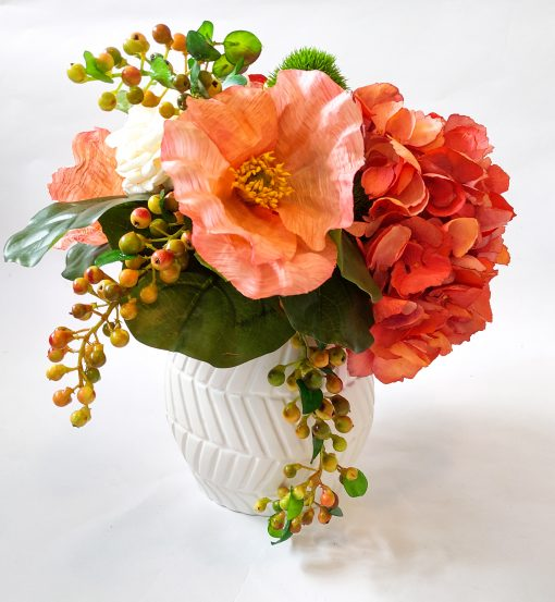 Orange artificial flower vase arrangement