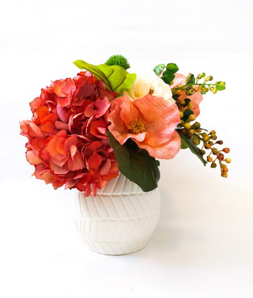 Orange artificial flower table vase arrangement
